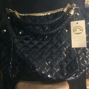JTarryn Big  Buddha Handbag with Gold Hardware.